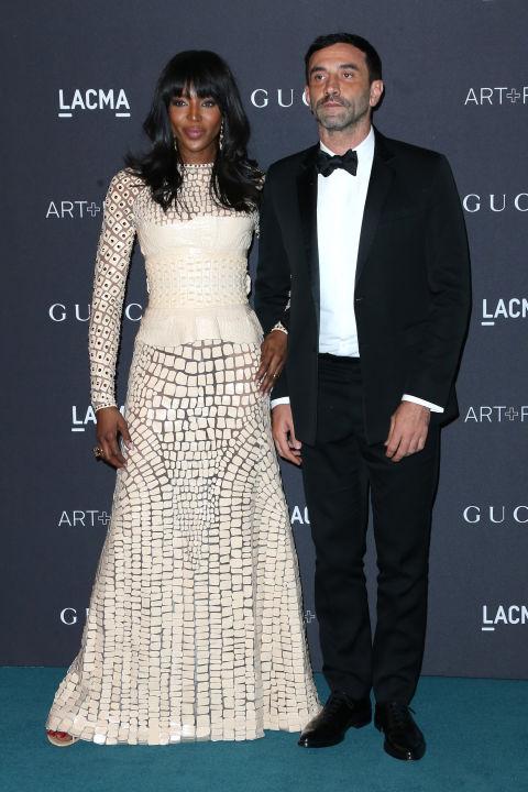 Наоми Кэмпбелл прибыла на мероприятие под руку с Рикадо Тиши в белоснежном платье от Givenchy.