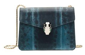 Праздник любопытных: что носит в сумке супермодель Миранда Керр?
